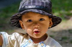 Baby using hat Royalty Free Stock Image