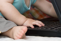 Baby using laptop Royalty Free Stock Photo