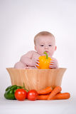 Baby in Vegetable Bowl Royalty Free Stock Photography