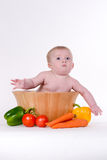 Baby in Vegetable Bowl Royalty Free Stock Images