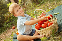 Baby and vegetables Stock Photos