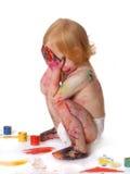 Baby in verf Stock Fotografie