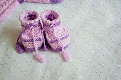 Baby violet booties Stock Image