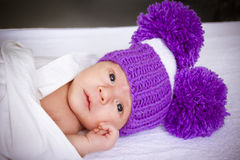 The baby in a violet knitted Royalty Free Stock Image
