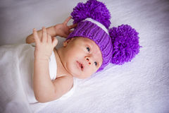 The baby in a violet knitted Royalty Free Stock Photos