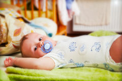 A baby waiting for changing his napkin Royalty Free Stock Images