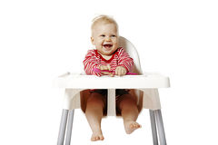 Baby Waiting For Dinner. Baby sitting on chair and waiting for dinner. Isolated on white Background Stock Photography
