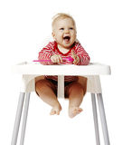 Baby Waiting For Dinner. Baby sitting on chair and waiting for dinner. Isolated on white Background Royalty Free Stock Photo