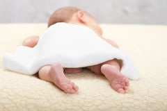 Baby is waiting for a massage Stock Images