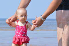 Baby walk with father support Stock Photos