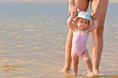Baby walk holding mother Stock Images