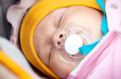 Baby on the walk sleeps with pacifier Stock Photography