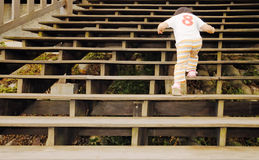 Baby walk in the wooden stair royalty free stock photo