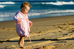 Baby walking on the beach Royalty Free Stock Photography