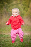 Baby Walking By The Road In Field Royalty Free Stock Image