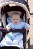 Baby walking in carriage Royalty Free Stock Images