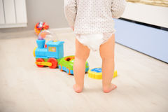 Baby walking in diaper Royalty Free Stock Image