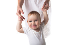 Baby walking holding hands mother, white background. Toddler baby boy walking holding hands mother, white background Stock Photography