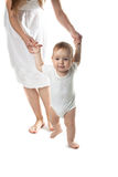 Baby walking holding hands mother, white background. Toddler baby boy walking holding hands mother, white background Royalty Free Stock Photography