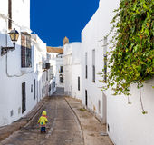 Baby walking on narrow street of Vejer de la Frontera Stock Photo