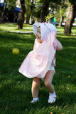Baby walking in the park. Stock Image