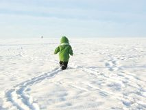 Baby walking in snow royalty free stock photo