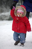 Baby walking in the snow Stock Photography