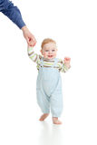 Baby walking steps first time Royalty Free Stock Images
