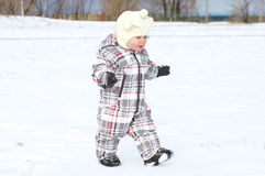 Baby walking in winter Royalty Free Stock Images