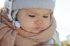 Baby in warm clothes Stock Photo