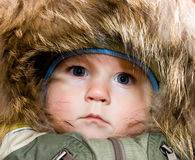 Baby in a warm jacket Royalty Free Stock Images