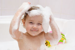 Baby is washing hair Royalty Free Stock Image