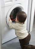 Baby and washing machine Royalty Free Stock Photography