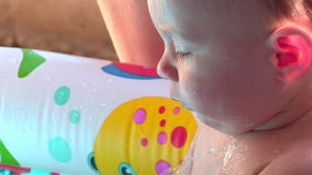 Baby in Wasser 01 stock footage
