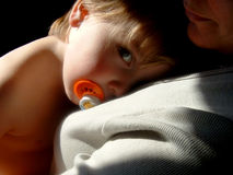 Baby Watching. A toddler keeps a watchful eye on the camera Stock Image