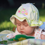 Baby is watching a book Stock Image