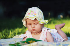 Baby is watching a book Royalty Free Stock Photography