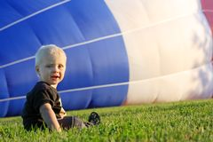 Baby Watching Hot Air Balloon Fill Royalty Free Stock Photo