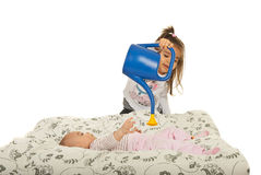 Baby is watered by her sister to grow Stock Image