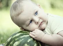 Baby with watermelon. Little baby with watermelon outdoors Stock Photo