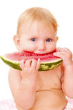 Baby with watermelon. Small baby eat watermelon isolated Stock Photography