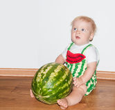 Baby and watermelon. Little baby boy and watermelon - sitting Royalty Free Stock Image