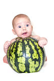 Baby on watermelon. Little baby with watermelon isolated on white Royalty Free Stock Photography
