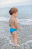 Baby in Waves Royalty Free Stock Photos