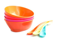 Baby weaning bowls with the spoons on a white back Stock Photo