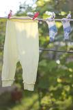 Baby wear in garden Royalty Free Stock Photography