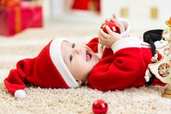 Baby weared Christmas clothes. Baby boy weared Christmas clothes at home stock images