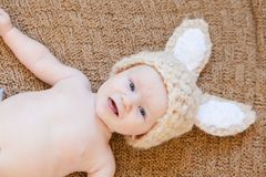 Baby Wearing Bunny Hat. Baby in knit hat with bunny ears. A fun idea for a knit or crochet craft outfit for easter or halloween Stock Image