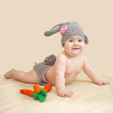 Baby is wearing in bunny's costume Stock Photos