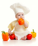 Baby wearing a chef hat with healthy  food vegetab. Portrait of a baby wearing a chef hat with healthy  food vegetables,  on white Royalty Free Stock Image